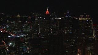 CAP_013_044 - HD stock footage aerial video reverse view of Midtown and downtown skyscrapers at night, Downtown and Midtown Atlanta, Georgia
