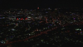 CAP_013_047 - HD stock footage aerial video of a wide view of the stadium and downtown skyline at nighttime, Downtown Atlanta, Georgia
