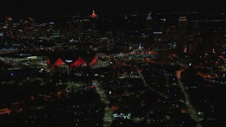 CAP_013_048 - HD stock footage aerial video of flying by the stadium near the downtown skyline at nighttime, Downtown Atlanta, Georgia
