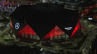 CAP_013_051 - HD stock footage aerial video of slowly orbiting the stadium at nighttime, Atlanta, Georgia