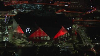 CAP_013_052 - HD stock footage aerial video of a reverse view of the stadium at nighttime, Atlanta, Georgia