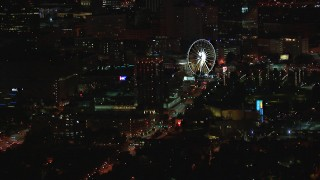 CAP_013_058 - HD stock footage aerial video of a condo complex and Ferris wheel at nighttime, Downtown Atlanta, Georgia