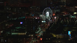 CAP_013_059 - HD stock footage aerial video of flying by a condo complex and Ferris wheel at nighttime, Downtown Atlanta, Georgia
