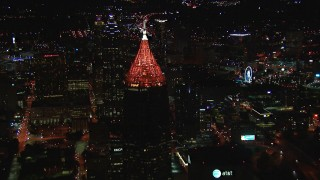 CAP_013_074 - HD stock footage aerial video fly away from Bank of America Plaza at night, Midtown Atlanta, Georgia