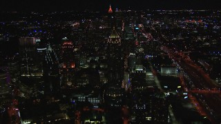 CAP_013_077 - HD stock footage aerial video fly away from One Atlantic Center and city buildings at night, Midtown Atlanta, Georgia