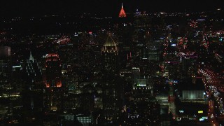 CAP_013_078 - HD stock footage aerial video approach One Atlantic Center, Bank of America Plaza in background at night, Midtown Atlanta, Georgia