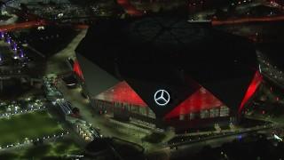 CAP_013_085 - HD stock footage aerial video of closely orbiting the stadium at night, Atlanta, Georgia