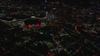 CAP_013_086 - HD stock footage aerial video of slowly flying toward and tilting to the stadium at night, Atlanta, Georgia