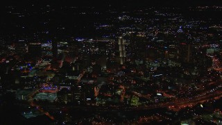 CAP_013_098 - HD stock footage aerial video of passing across city buildings and skyscrapers at night, Downtown Atlanta, Georgia