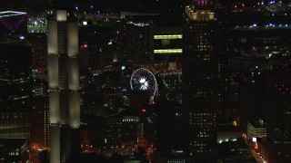 CAP_013_099 - HD stock footage aerial video of flying by skyscrapers to reveal the Ferris wheel at night, Downtown Atlanta, Georgia
