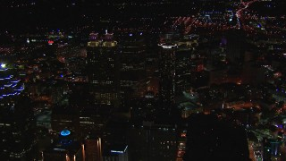 CAP_013_102 - HD stock footage aerial video fly away from tall city skyscrapers at night, Downtown Atlanta, Georgia