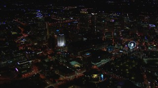 CAP_013_103 - HD stock footage aerial video reverse view of tall city skyscrapers at night, Downtown Atlanta, Georgia