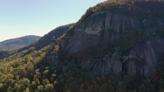 CAP_014_001 - 2.7K stock footage aerial video of a flag waving atop Chimney Rock in North Carolina
