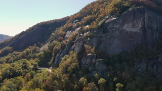 CAP_014_002 - 2.7K stock footage aerial video of orbiting a flag atop Chimney Rock in North Carolina