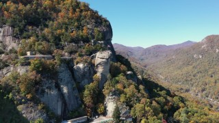 CAP_014_003 - 2.7K stock footage aerial video of orbiting the rock formation at Chimney Rock in North Carolina