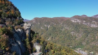 CAP_014_004 - 2.7K stock footage aerial video of approaching the rock formation and mountains at Chimney Rock in North Carolina