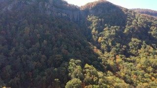 CAP_014_006 - 2.7K stock footage aerial video of ascend and focus on a waterfall at Chimney Rock, North Carolina
