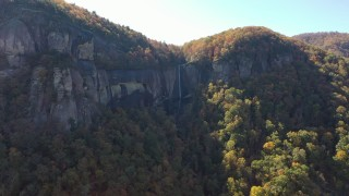 CAP_014_007 - 2.7K stock footage aerial video of ascend while focused on a waterfall at Chimney Rock, North Carolina