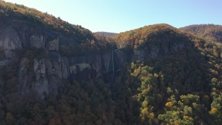 CAP_014_008 - 2.7K stock footage aerial video of flying away from a waterfall at Chimney Rock, North Carolina