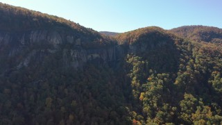 CAP_014_009 - 2.7K stock footage aerial video reverse view of a waterfall at Chimney Rock, North Carolina