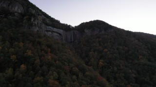 CAP_014_011 - 2.7K stock footage aerial video approach a waterfall at sunset, Chimney Rock, North Carolina