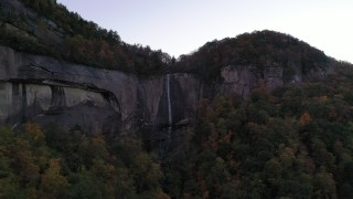 CAP_014_012 - 2.7K stock footage aerial video a clifftop waterfall at sunset, Chimney Rock, North Carolina