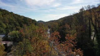 CAP_014_025 - 2.7K stock footage aerial video fly over river and reveal a bridge, Chimney Rock, North Carolina
