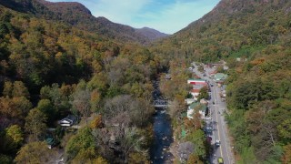 CAP_014_034 - 2.7K stock footage aerial video of a river and a road in a small town, Chimney Rock, North Carolina