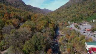 CAP_014_035 - 2.7K stock footage aerial video fly over a river by a small town road, Chimney Rock, North Carolina