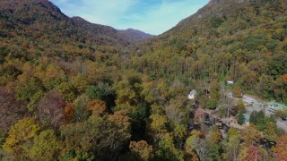 CAP_014_036 - 2.7K stock footage aerial video forest and mountains seen from small town, Chimney Rock, North Carolina