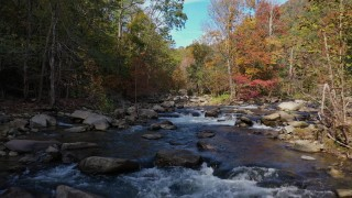 CAP_014_037 - 2.7K stock footage aerial video fly low over the river surrounded by forest trees, Chimney Rock, North Carolina