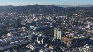 CAP_016_009 - HD stock footage aerial video orbit apartment and college with view of office buildings in Hollywood, California