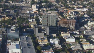 CAP_016_012 - HD stock footage aerial video tilt to and approach college and apartment building in Hollywood, California