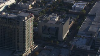 CAP_016_022 - HD stock footage aerial video approach to college beside apartment complex, Hollywood, California