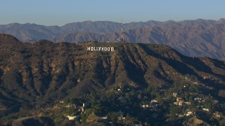 CAP_016_030 - HD stock footage aerial video of flying by the Hollywood Sign in Los Angeles, California