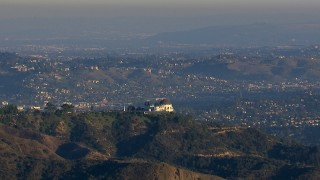 CAP_016_036 - HD stock footage aerial video orbit Griffith Observatory in Los Angeles, California