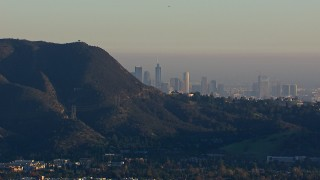 CAP_016_039 - HD stock footage aerial video of a wide view of the city's skyline eclipsed by mountains, Downtown Los Angeles, California