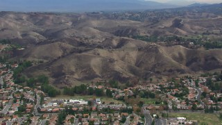 CAP_018_008 - HD stock footage aerial video of orbiting hills scarred by fire, Malibu, California