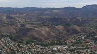 CAP_018_010 - HD stock footage aerial video of circling hills scarred by fire, Malibu, California