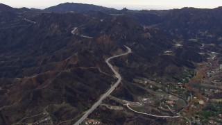 CAP_018_013 - HD stock footage aerial video of mountains and road scarred by fire, Malibu, California