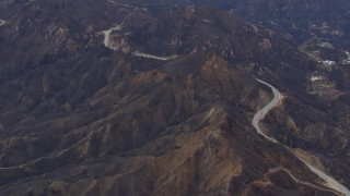 CAP_018_014 - HD stock footage aerial video of flying by road by mountains scarred by fire, Malibu, California