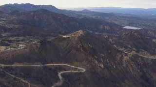 CAP_018_018 - HD stock footage aerial video of mountains scarred by fire, Malibu, California