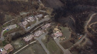 CAP_018_021 - HD stock footage aerial video of a bird's eye view of homes destroyed by fire, Malibu, California