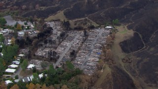 CAP_018_030 - HD stock footage aerial video of orbiting a neighborhood destroyed by fire, Malibu, California