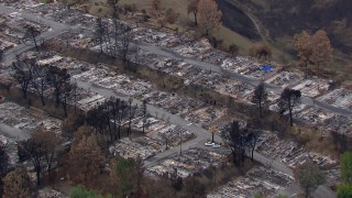 CAP_018_031 - HD stock footage aerial video of circling a neighborhood destroyed by fire, Malibu, California
