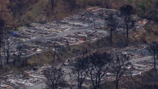 CAP_018_035 - HD stock footage aerial video of a reverse view of a neighborhood devastated by fire, Malibu, California