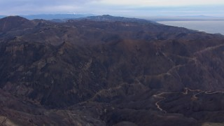CAP_018_038 - HD stock footage aerial video of flying by mountains devastated by fire, Malibu, California