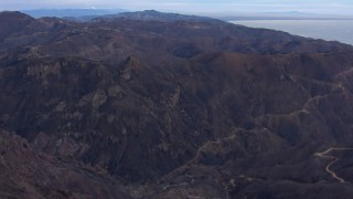 CAP_018_039 - HD stock footage aerial video of flying over mountains scorched by fire, Malibu, California