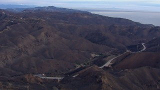 CAP_018_041 - HD stock footage aerial video of mountains scorched by fire, Malibu, California