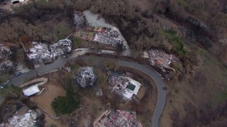 CAP_018_045 - HD stock footage aerial video approach homes destroyed by fire, Malibu, California